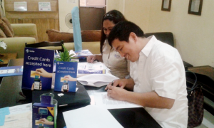 Kristoffer Atienza signs contract with Globe represented by SDI that facilitates Globe Charge