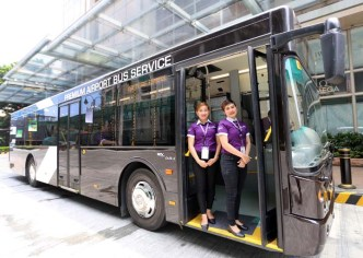 UBE Express bus steward Ma. hecelyn s. espinosa and Mikee anne a. Sambajon after The Department of Transportation and the Land Transportation Franchising and Regulatory Board (LTFRB) in Pasay City launch the UBE Express which aimed to introduce a premium bus service at Ninoy Aquino International Airport.(photo by ali vicoy)
